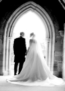 Bride and father in doorway